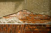 pic of divergent  - Naturally aged brick wall repaired with divergent pieces - JPG