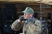 KIEV, UKRAINE -NOV 3: An unidentified members of Red Star history club wear historical German uniform during historical reenactment of WWII, Dnepr river crossing 1943, November 3, 2013. Kiev, Ukraine