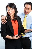 stock photo of pushy  - Asian Chinese Employee or secretary getting manager or business man sexual harassed or harassment and reject him - JPG