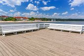 SOPOT, POLAND - 7 JUNE: Sopot molo at Baltic Sea, 7 June 2014. Sopot is major health and tourist resort destination and this pier with 511.5 meters long is the longest wooden pier in Europe.