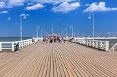 SOPOT, POLAND - 7 JUNE: Sopot molo at Baltic Sea on 7 June 2014. Sopot is major health and tourist resort destination and this pier with 511.5 meters long is the longest wooden pier in Europe.