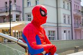 SOPOT, POLAND - 7 JUNE: Man in spiderman outfit in main square of Sopot molo on 7 June 2014. Sopot is major health and tourist resort destination and has the longest wooden pier in Europe.