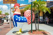 MIAMI,USA - MAY 19,2014 : Symbolic rooster sculpture with the colors of the cuban and the american f