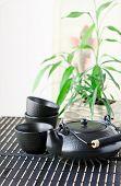 still life with black oriental teapot set