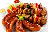 Grilled meat, sausages and vegetables