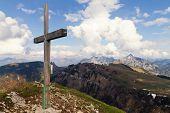 Wooden Cross On The Mountain In The Austrian Alps