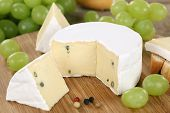 image of brie cheese  - Cheese plate with soft cheese like Camembert or Brie on a wooden board