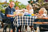 pic of bbq party  - Family having a barbecue in the garden - JPG