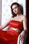 foto of throne  - princess woman in a red dresssitting on throne - JPG