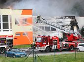 PILSEN, CZECH REPUBLIC - JUNE 12 2014: unidentified professional firefighters extinguishing burning