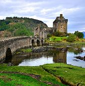 stock photo of british culture  - Picturesque Eilean Donan Castle in the highlands of Scotland - JPG