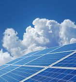 Blue solar power panels generating renewable energy