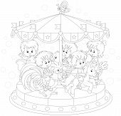 stock photo of amusement park rides  - Children riding on a funny carousel in an amusing park - JPG