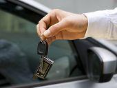Man Handing A Car Keys