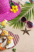 Sandals, Hat, Sunglasses And Shells On The Sand. Summer Beach Concept, Vertical Composition