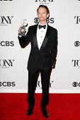 NEW YORK-JUNE 8: Actor Neil Patrick Harris poses in the press room at the American Theatre Wing's 68