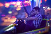Young couple having fun in bumper car
