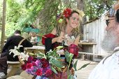 MUSKOGEE, OK - MAY 24: A woman in historical costume sells her crafts at the Oklahoma 19th annual Re