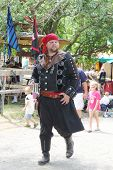 MUSKOGEE, OK - MAY 24: A man dressed as a pirate stops to talk during the Oklahoma 19th annual Renai