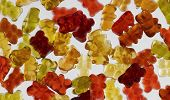 pic of jelly babies sugar  - some colorful gummy bears in light back - JPG