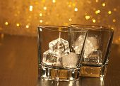 Two Empty Whiskey Glasses On Wood Table