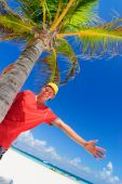 Teen by palm tree