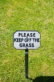 picture of manicured lawn  - Keep Off The Grass Notice on a well manicured lawn