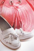 image of loafers  - Closeup of shoes and bag on white background - JPG