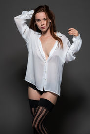 picture of panty-hose  - Pretty pale redhead in a white blouse and black panties - JPG