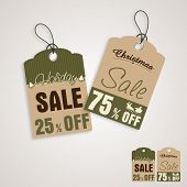 Sale tag or label for Merry Christmas and other occasion on shiny grey background.