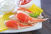 image of cooked blue crab  - crab claws and sauce on a table - JPG