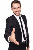 Portrait of smiling businessman offering handshake on white background