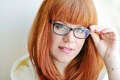 stock photo of redheaded  - portrait of caucasian redhead girl with glasses - JPG
