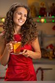 Portrait Of Happy Young Woman Drinking Tea In Christmas Decorate