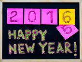 Happy New Year 2016 message hand written on blackboard