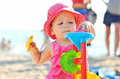 Baby Playing Toys On The Beach