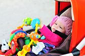 Baby In Stroller  With Toys