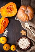 Pumpkins And A Bowl With Toasted Pumpkin Seeds, Wooden Spoon