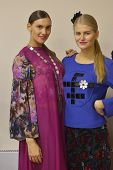 NOVOSIBIRSK, RUSSIA - NOVEMBER 15, 2014: Models dressed for the fashion parade during Novosibirsk Fashion Week. The event was held under the motto High Fashion & High Classics