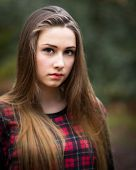 Portrait Of A Beautiful Dark Blond Teenage Girl In A Forest