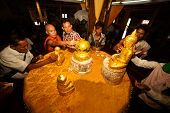 Peoples is gilding gold leaf at famous five small Buddhas images.