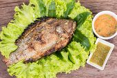 picture of snakehead  - salt grilled fish with spicy sauce local foods of thailand - JPG