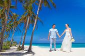 young loving couple on tropical sand beach, outdoor beach wedding
