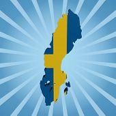 Sweden map flag on blue sunburst illustration