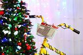 Yellow bicycle near Christmas tree
