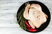 Raw chicken on wooden table