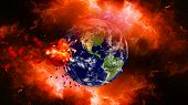 Earth burning or exploding after a global disaster, Apocalypse asteroid impact globe.