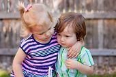 Toddler Girl and Boy Hugging