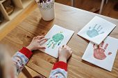 child hands with christmas handprints postcard