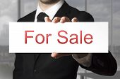 Businessman Showing Sign For Sale